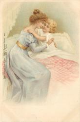 mother in light blue hugs child in bed