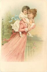 mother in pink dress carries child piggy-back