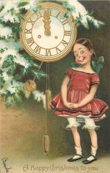 A HAPPY CHRISTMAS TO YOU  girl with pig tails, in purple dress, stands to right of clock