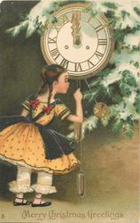 MERRY CHRISTMAS GREETINGS  girl with pig tails, in yellow dress, touches weight chain of clock
