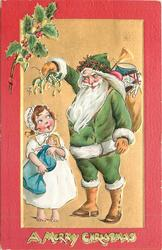 A MERRY CHRISTMAS  at bottom, green robed Santa holds mistletoe over girl with doll