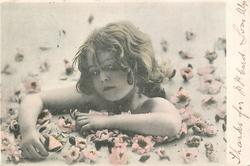 girl immersed in flowers, her hands do not touch