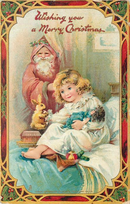 WISHING YOU A MERRY CHRISTMAS  pinkish red robed Santa peeks at girl sitting on bed with doll & rabbit