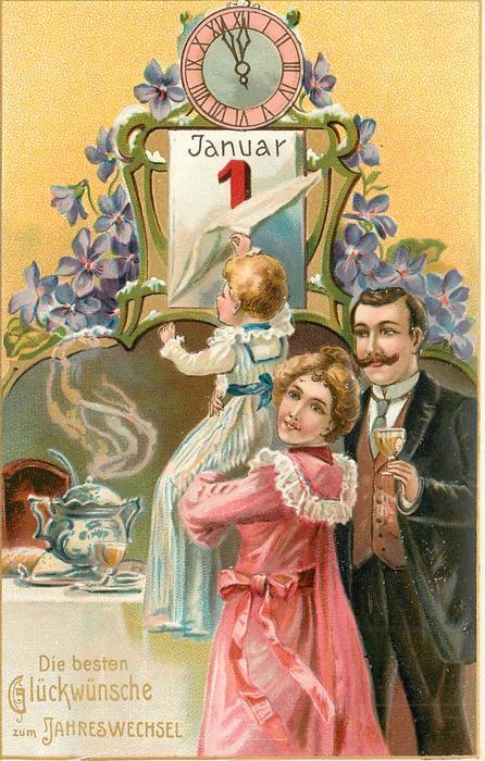 DIE BESTEN GLUCKWUNSCHE ZUM JAHRESWECHSEL woman holds up child to reveal date, clock above, man with wine to right