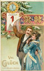 VIEL GLUCK ZUM NEUEN JAHRE  man embraces woman whilst turning calendar page with his right hand