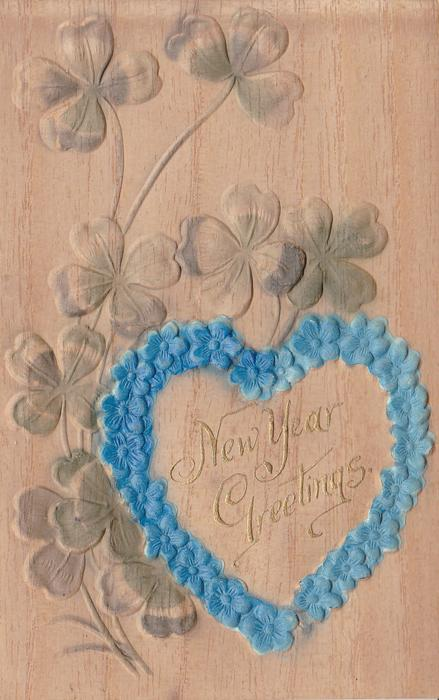 CHRISTMAS GREETINGS framed by heart of flowers, clover