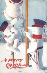 three snowman dressed as German soldiers, two snowman climb up a tree while other points