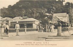 CASTRIES, CASTRIES BRIDGE SHOWING POLICE OFFICERS, ROYAL GOAL AND DISPENSARY
