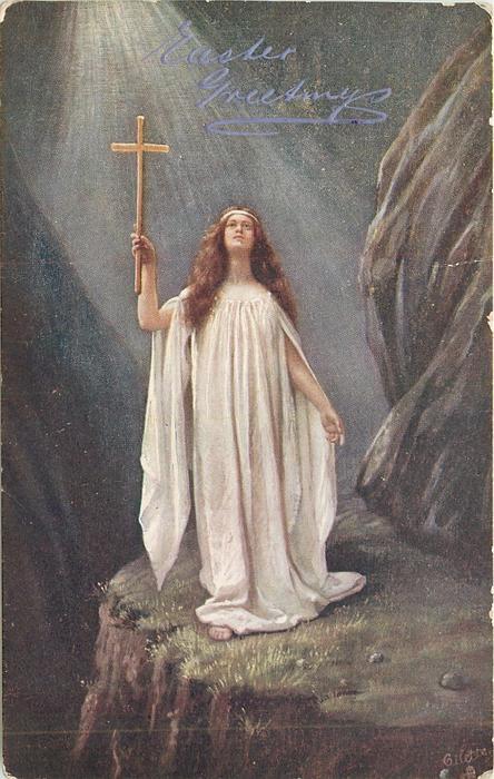 angel on cliff ledge holding up golden cross