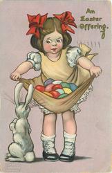 AN EASTER OFFERING  girl carries many coloured Easter eggs in her skirt, rabbit lower left
