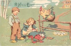 A HAPPY EASTER  boy watches girl paint egg, hen & rooster sit on fence