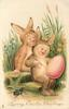 LOVING EASTER GREETINGS two children in rabbit costumes, one paints large Easter egg