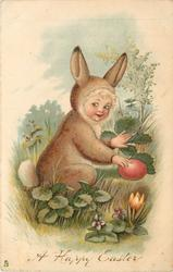 A HAPPY EASTER  child in rabbit costume touches red Easter egg