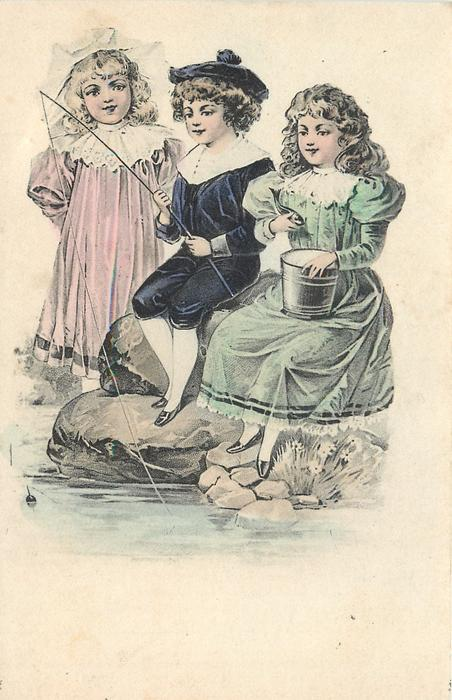 boy sits fishing between two girls, one has pail on her lap