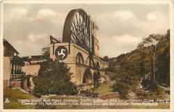 LAXEY WHEEL AND MANX EMBLEM T.O.M. ERECTED 1854. CIRCUMFERENCE 227 FEET. DIAMETER 72 1/2 FEET. BREADTH 6 FEET. PUMPS 200 GALS. / HORSE POWER 200