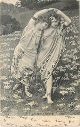 two woman dancing in field of flowers
