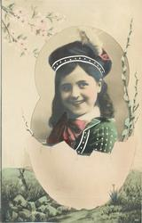 girl faces left, looks front, wearing tam & large bow on collar, pussy willow right, pink flowers upper left