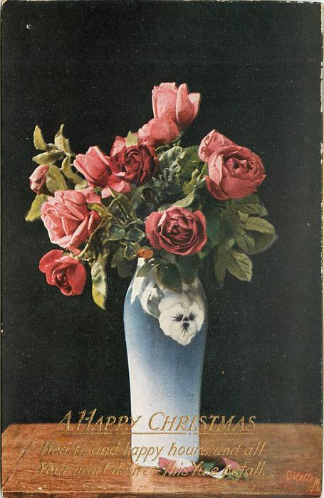 many red roses in blue /white vase on table, two petals on table