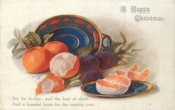 A HAPPY CHRISTMAS plates with four oranges, one peeled & three plums