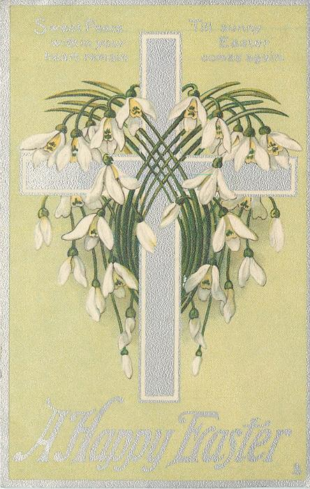 A HAPPY EASTER silver cross with snowdrops around