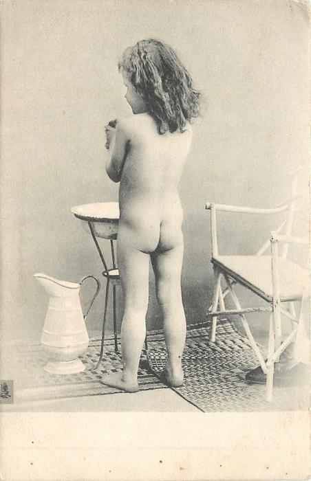 nude girl faces away in front of washbowl