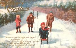three children cheer another child on a toboggan, two children with a toboggan in the background