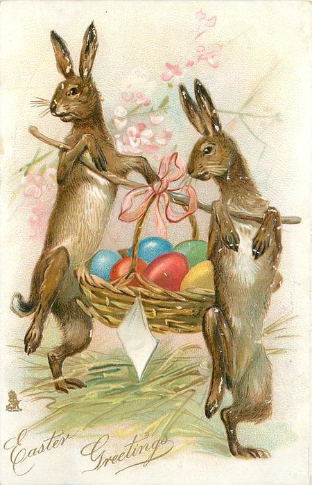EASTER GREETINGS two rabbits on their hind legs carry basket of easter eggs slung on a stick between them