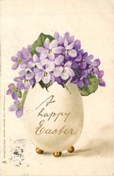 A HAPPY EASTER  egg on stand pointing up containing bunch of violets