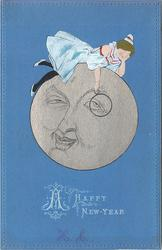 A HAPPY NEW YEAR girl lies on gilt face of man in moon holding hIs monacle in position art nouveau