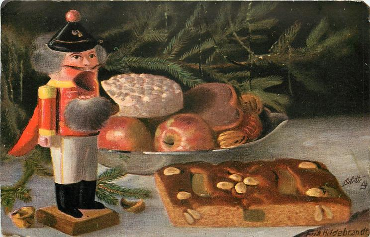 toy soldier (nut-cracker) to left of plate of biscuits and apples, cake in front to right
