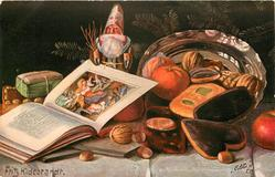 small santa stands beside plate & behind book, orange, nuts & biscuits around