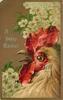A HAPPY EASTER cockerel faces left, beak open, blossoms behind