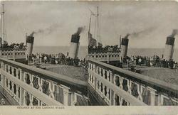 STEAMER AT THE LANDING STAGE