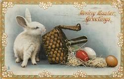 LOVING EASTER GREETINGS rabbit tips over basket filled with Easter eggs