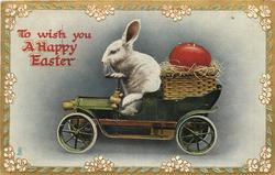 TO WISH YOU A HAPPY EASTER rabbit drives car left, basket with red egg in back