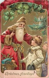 CHRISTMAS GREETINGS  Santa has his left hand on head of boy