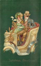 CHRISTMAS GREETINGS  couple in antique car, driving left, green background