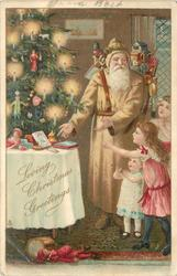 LOVING CHRISTMAS GREETINGS  fawn coated Santa carrying puppets on his back shows presents & tree to three children