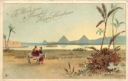 TO WISH YOU A PEACEFUL HAPPY CHRISTMAS  man with woman riding donkey move right, pyramids in background across nile **