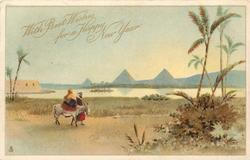 WITH BEST WISHES FOR A HAPPY NEW YEAR  man with woman riding donkey move right, pyramids in background across nile **