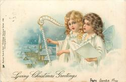 *LOVING CHRISTMAS GREETINGS one angel plays harp, the other sings, winter church scene in background