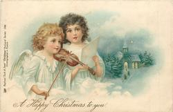 **A HAPPY CHRISTMAS TO YOU one angel plays violin, the other sings, winter church scene in background