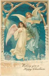 **WISHING YOU A HAPPY CHRISTMAS  two angels float over town, one reads, one carries tree