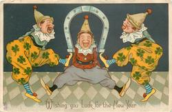 WISHING YOU LUCK FOR THE NEW YEAR  two clowns with horseshoe between them