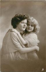 mother & girl in filmy dress have arms round each other, girl faces front ,mother faces right, both look front