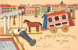 A MERRY CHRISTMAS TO YOU  FROM  prostrate wooden figure front left, wooden horse & van moves left, houses behind