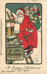A HAPPY CHRISTMAS TO YOU  Santa carrying toys, climbs ladder next to YE JOLLY HUNTSMAN sign