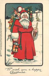 TO WISH YOU A HAPPY CHRISTMAS  Santa standing in snow carrying very large sack of toys