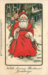 WITH LOVING CHRISTMAS GREETINGS  Santa, toys on back,sits against large tree, dwarves peek