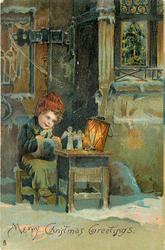 MERRY CHRISTMAS GREETINGS  child sitting at small table, lantern, angels, etc